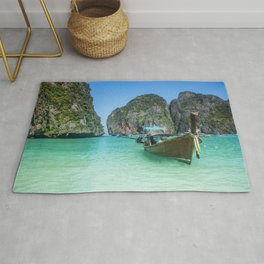 Paradise Island. Long-tail boat floating in transparent water of Maya Bay beach, Thailand. Rug