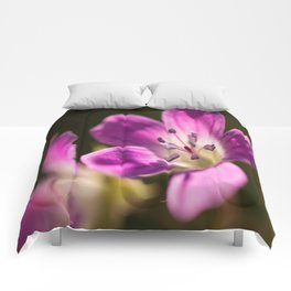 Purple flowers glow in forest #decor #buyart #society6 Comforters