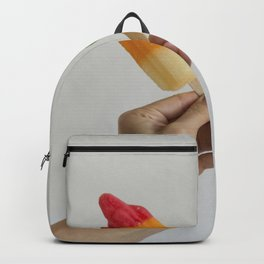 Hand holding two popsicles Backpack