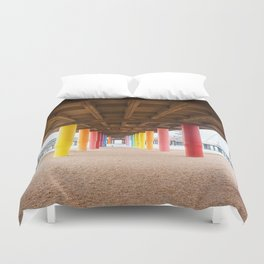 Pier with color painted columns on the beach Duvet Cover