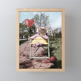 A pretty, little kitty with a heart-shaped balloon Framed Mini Art Print
