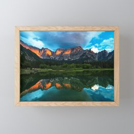 Burning sunset over the mountains at lake Fusine, Italy Framed Mini Art Print