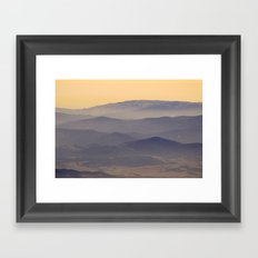 Sunset at the foggy mountains Framed Art Print