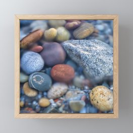 Colorful pebbles covered by ocean water Framed Mini Art Print