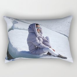 Girl in warm down-padded coat enjoys a look at snow top. Rectangular Pillow