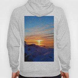 Sun sets on frozen land Hoody