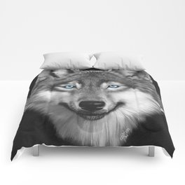 Wolf with blue eyes Comforters