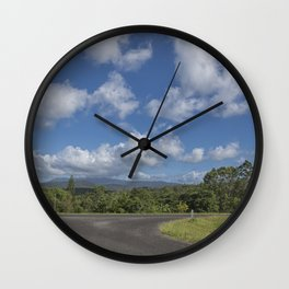 View to the hills from a rural road Wall Clock