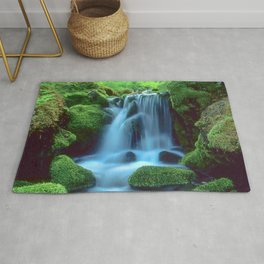 Waterfall in the forest Rug