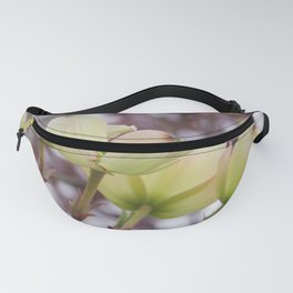 yellow dogwood flowers on black maple bokeh Fanny Pack