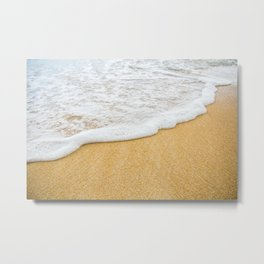 Foamy sea water is washing sandy beach Metal Print