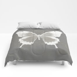 Butterfly on grunge surface Comforters