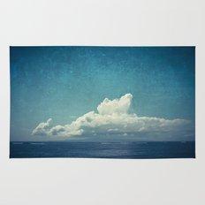 cloud over island Rug
