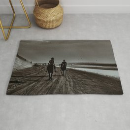 Young Couple Riding Horses at the Beach Rug