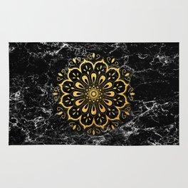 Gold mandala on black marble Rug