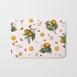 Oranges and Butterflies in Blush Bath Mat
