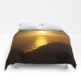 Sunset over the Canary islands Comforters