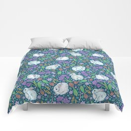 Cute rabbits amount birch blossom and purple crocuses on dark background Comforters