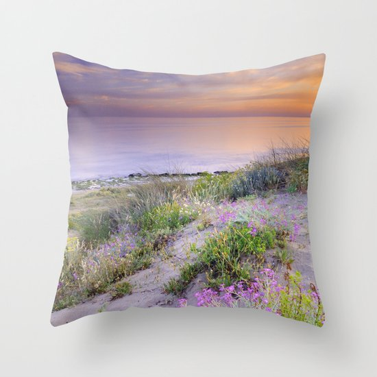 Sunset at the beach. Flowers on the sand. Throw Pillow