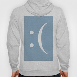 sad face sign on placid blue background Hoody