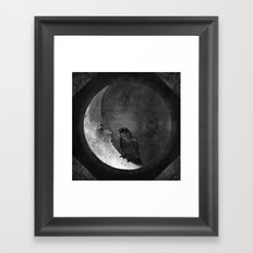 The crow and its moon. Framed Art Print