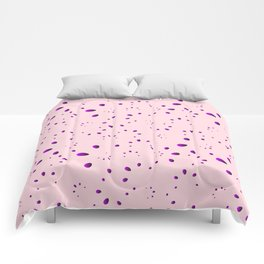 A lot of blueberry drops and petals on a pink background in mother of pearl. Comforters