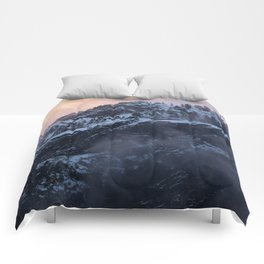 Morning in the snowy mountains Comforters