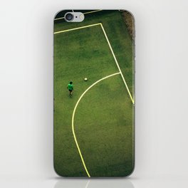 Kids are playing football on the green field iPhone Skin