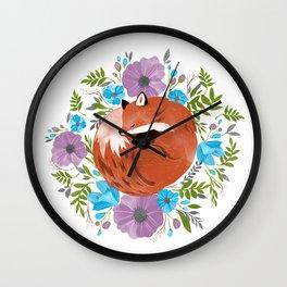 Sleepy fox in a bed of flowers Wall Clock