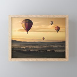 Hot Air Balloons Floating Over a Foggy Landscape Framed Mini Art Print
