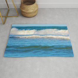 Abstract vibrant splashing waves off the coast of Queensland Rug