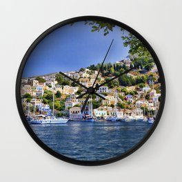 Symi island in Greece. Traditional houses. Sunny day with blue sky and sea. Wall Clock