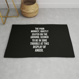 The poor monkey quietly seated on the ground seemed to be in sore trouble at this display of anger Rug
