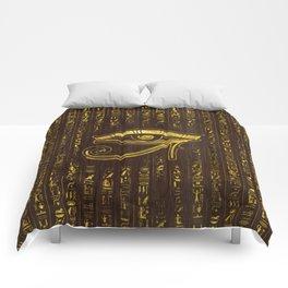 Golden Egyptian Eye of Horus  and hieroglyphics on wood Comforters