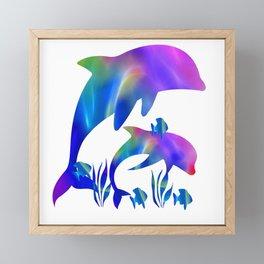 Rainbow Dolphins swimming in the sea Framed Mini Art Print