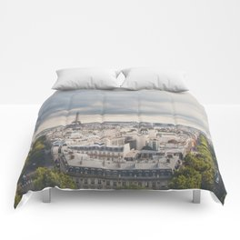 the Eiffel Tower in Paris on a stormy day. Comforters