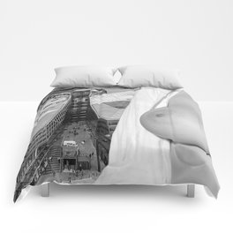 Enjoying the views. Nude woman over the city of London Comforters