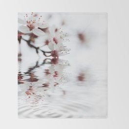 white cherry blossom and water reflection Throw Blanket