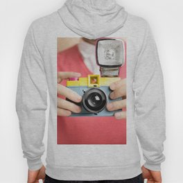 photographer holding toy plastic camera with flash Hoody
