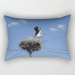 A Stork family in their nest on a telegraph pole. Rectangular Pillow