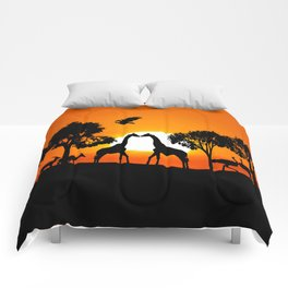 Giraffe silhouettes at sunset Comforters
