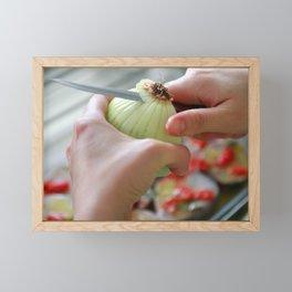 Cutting an onion Framed Mini Art Print