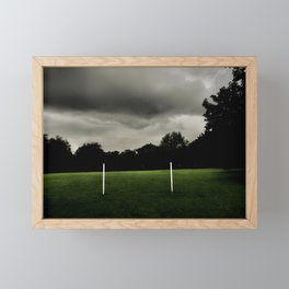 Football goalposts in an empty field Framed Mini Art Print