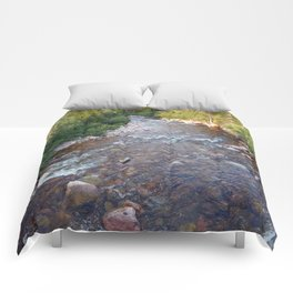 Iron rich river flows from high mountain Comforters
