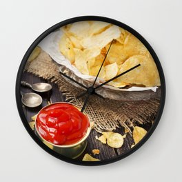 Potato chips with dipping sauces on a rustic table Wall Clock