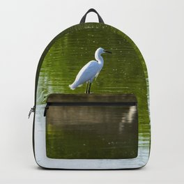 White Egret standing over reflection in green water Backpack