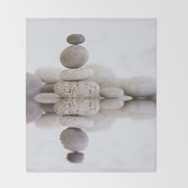 Stone Balance pebble cairn and water Throw Blanket