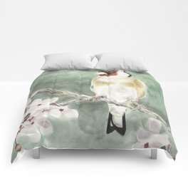 Goldfinch in blossom on green Comforters