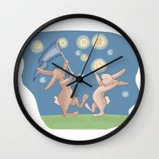 Bunnies Catching Fireflies Wall Clock