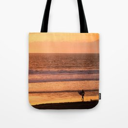 Surfer watching sunset in Southern California Tote Bag